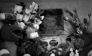 "A PHOTO OF LISSETTE decorates her tomb in Til Til, Chile, on Oct. 22. Lissette died under the care of the Chilean state, suffocating in her own vomit while a caretaker allegedly sat on her back while trying to contain the 11-year-old during what was described as ""a crisis of aggressiveness."""