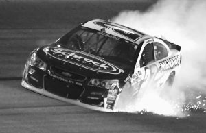 PAUL MENARD'S car drags and makes sparks after losing a tire during the NASCAR Sprint Cup Series auto race at Texas Motor Speedway in Fort Worth, Texas, on Sunday. Carl Edwards won the rain-shortened race.