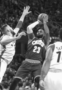 CLEVELAND CAVALIERS' LeBron James (23) shoots over Toronto's Jonas Valanciunas during the first half of an NBA basketball game in Cleveland on Tuesday. The Cavaliers won, 121-117.