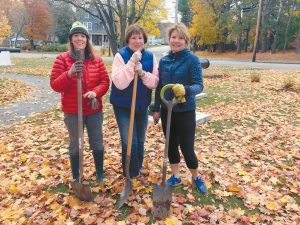 VOLUNTEERS FROM THE FREEPORT COMMUNITY IMPROVEMENT ASSOCIATION planted 200 tulip bulbs at Bow Street Park and 200 daffodil bulbs at the Exit 20 and Exit 24 welcome signs on Sunday. Pictured, left to right, are Michele Morrison, Sande Updegraph and Tammy Davenport.) FCIA works on beautification projects in town and funds these projects through private donations. Past efforts include gardens at Exit 22, granite benches throughout the downtown, granite and wrought iron fence and gardens at the Freeport Historical Society, new plantings at the Community Library.