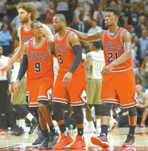CHICAGO BULLS GUARD Dwyane Wade (3) walks with Rajon Rondo (9) and Jimmy Butler (21) during a timeout in the second half of an NBA basketball game against the Miami Heat on Thursday in Miami. Wade, a longtime Heat, returned to Miami as a visitor for the first time.
