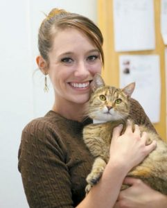 MORGAN FULLER, pictured with shelter cat Rose, is the new Volunteer Coordinator for Coastal Humane Society and Lincoln County Animal Shelter.