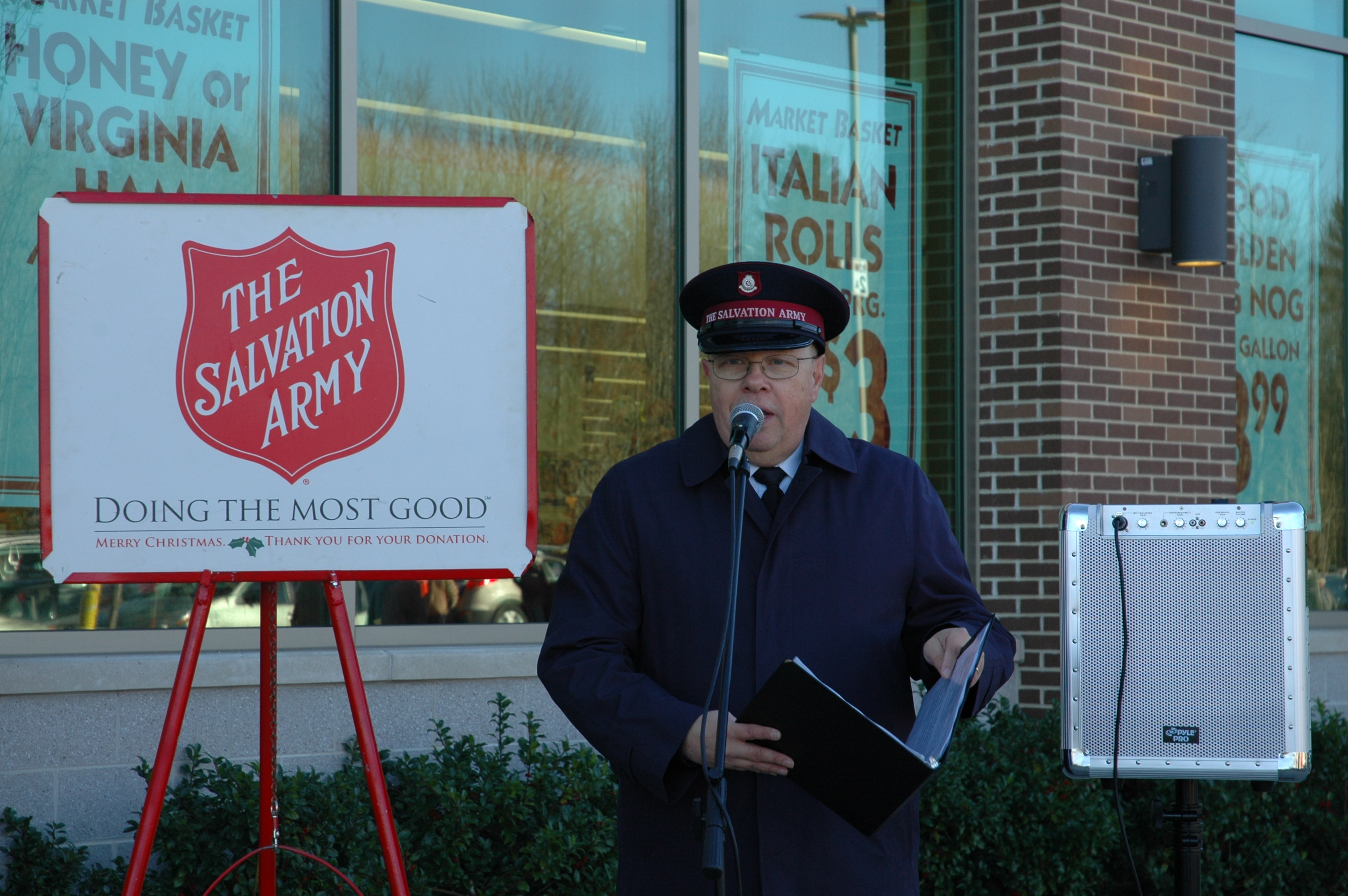 Salvation Army Major B. Bryan Smith speaks Saturday morning at the Red Kettle Christmas Campaign kick off in front of Market Basket in Biddeford Saturday.