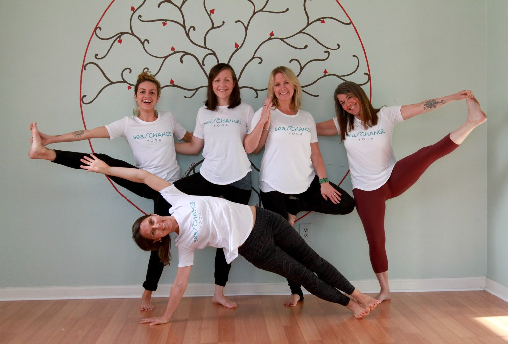 Board members and yoga instructors at Sea Change Yoga in Portland loosen up. From left, top row are Jennie Tavares, Lee Sowles, Melea Nallli and Diana Lee.  In front is Jen Queally. (Staff photo by Melanie Sochan.)