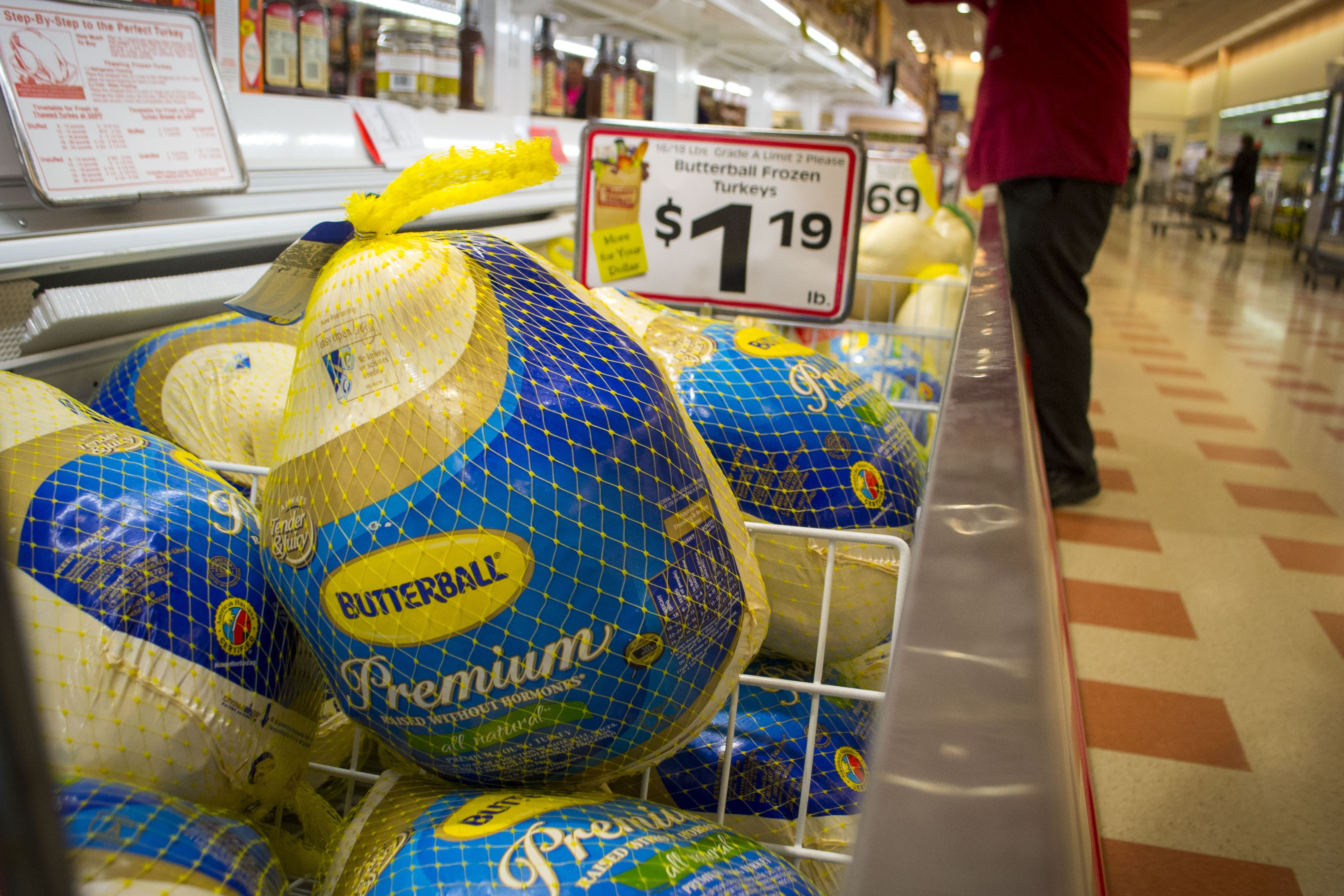 A number of frozen turkeys for sale at Market Basket in Biddeford on Tuesday. The U.S. Department of Agriculture recommends defrosting turkeys in the refrigerator, in cold water or in the microwave. ALAN BENNETT/Journal Tribune