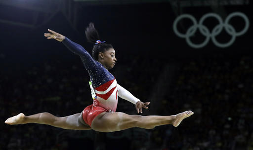 Simone Biles performs on the balance beam during the gymnastics women's team final at the Summer Olympics. Biles was selected as the AP Female Athlete of the Year on Monday.  Associated Press/Rebecca Blackwell