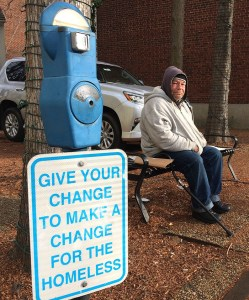 Joe Drury, who says he is homeless, sits near a parking-style meter in Annapolis, Md., used to collect loose change from those who might otherwise give money to those begging on the street. Drury says the meters may help charities, but they do nothing for him. Associated Press/Pat Eaton-Robb