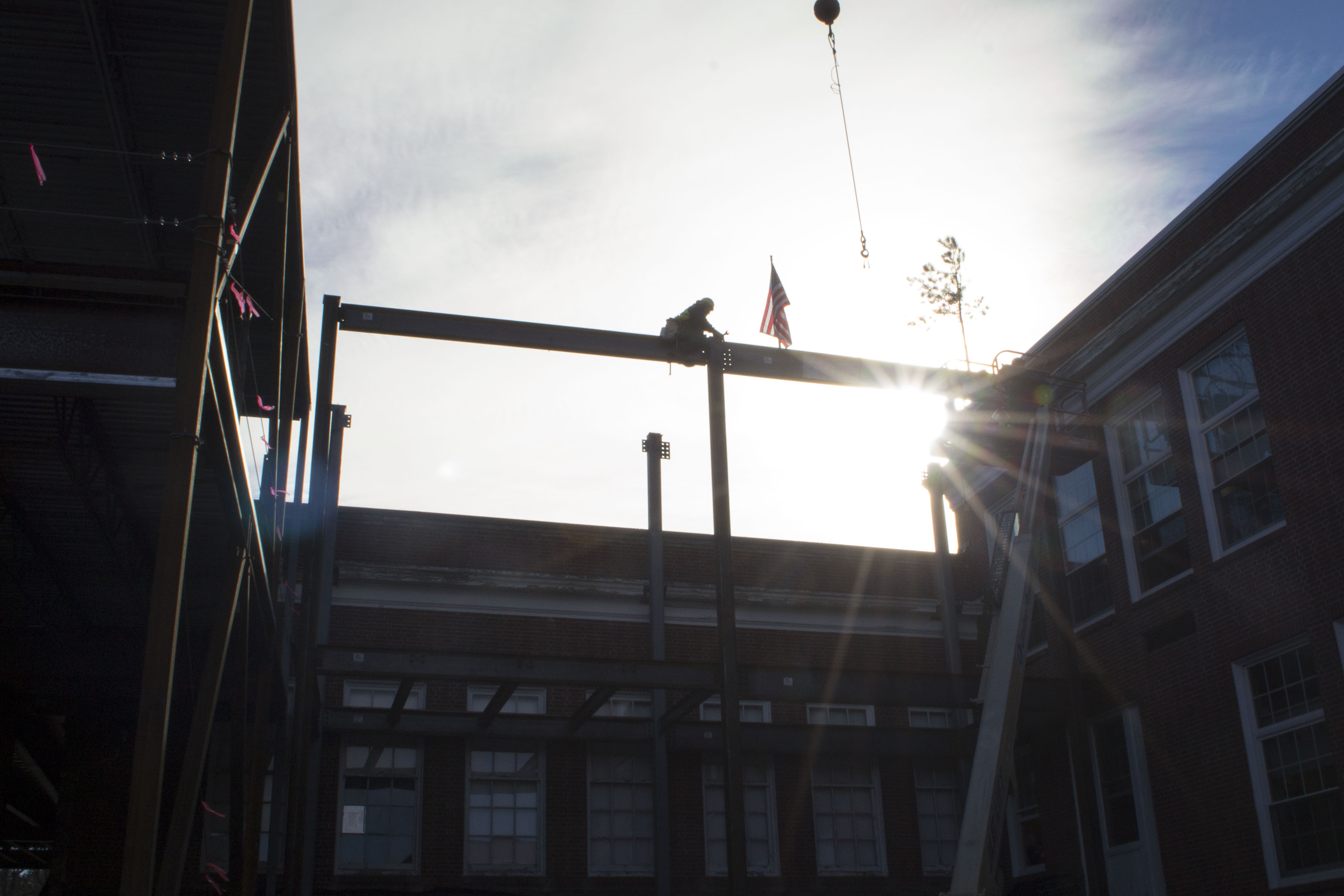 ALAN BENNETT/Journal TribuneThe final beam of Kennebunk High School's renovation is placed on Friday, connecting the new facilities to the school's original 1939 building.