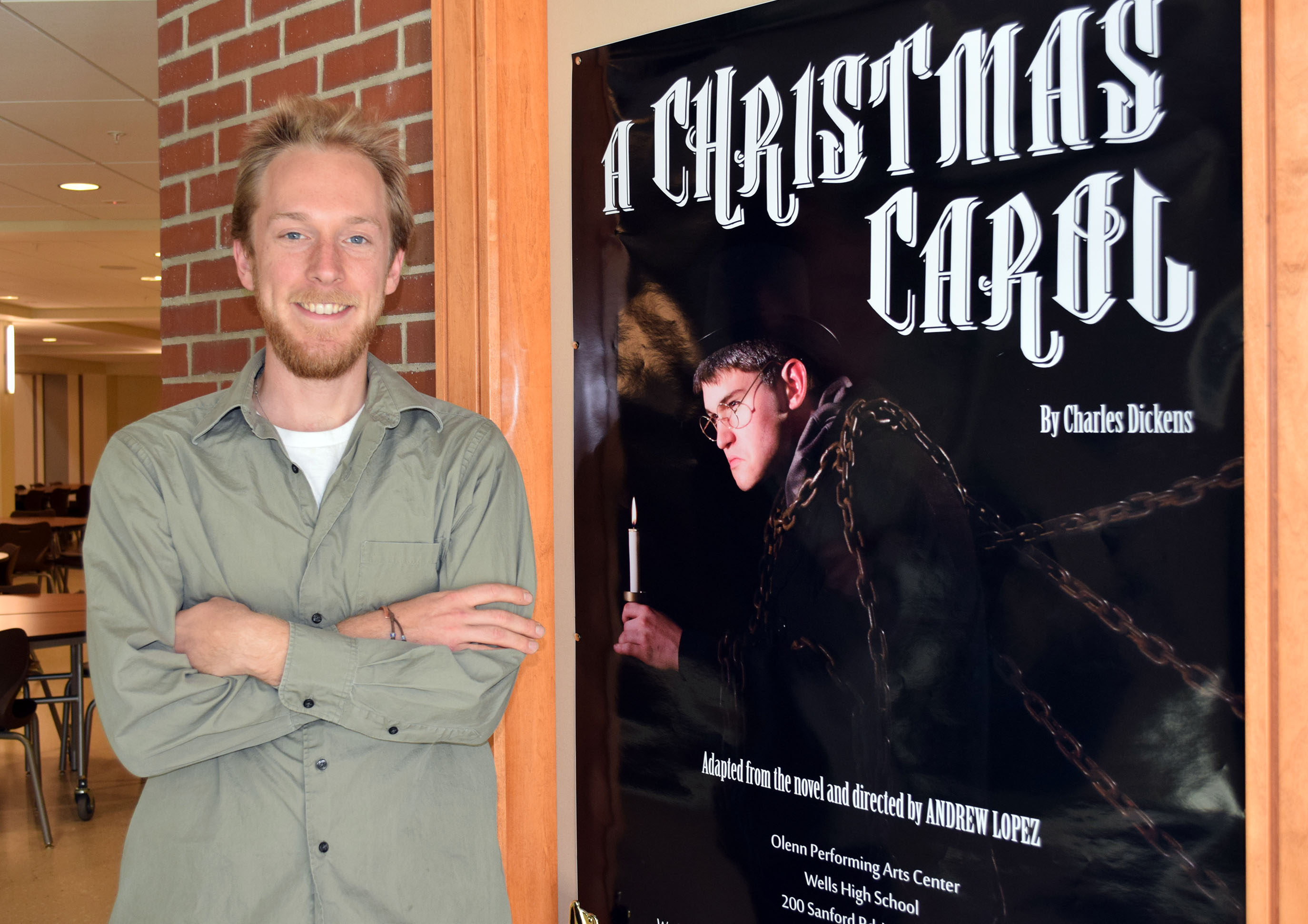 SUBMITTED PHOTO/Courtesy of Reg BennettAssistant Director David Littlefield is pictured next to a poster for