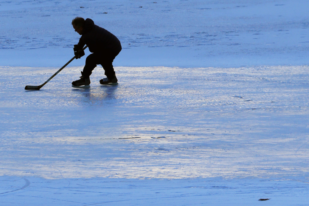 Bo Hewey of Portland practices Friday on Deering Oaks Pond for an upcoming hockey match in Rangeley. The city of Portland maintains several ponds ideal for ice skating.