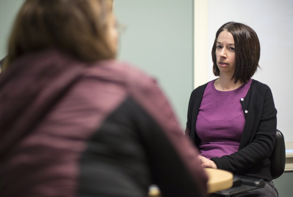 """Addiction specialist Dr. Kristen Silvia, right, consults in Scarborough with a patient to whom she prescribes Suboxone. """"Our biggest hurdle is the uninsured,"""" she said."""