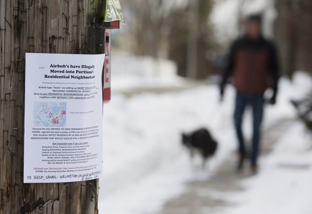 Opponents of short-term rentals posted signs like this one earlier this year. Critics worry that the rentals eat into year-round apartment availability, drive up housing prices and disrupt community character.