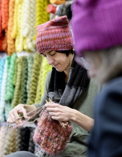 Casey Ryder, owner of PortFiber, knits a hat for the Pussyhat Project on Thursday. The hats will be worn by women at protest marches in Washington and elsewhere on Jan. 21, the day after the inauguration of Donald Trump as the 45th president.