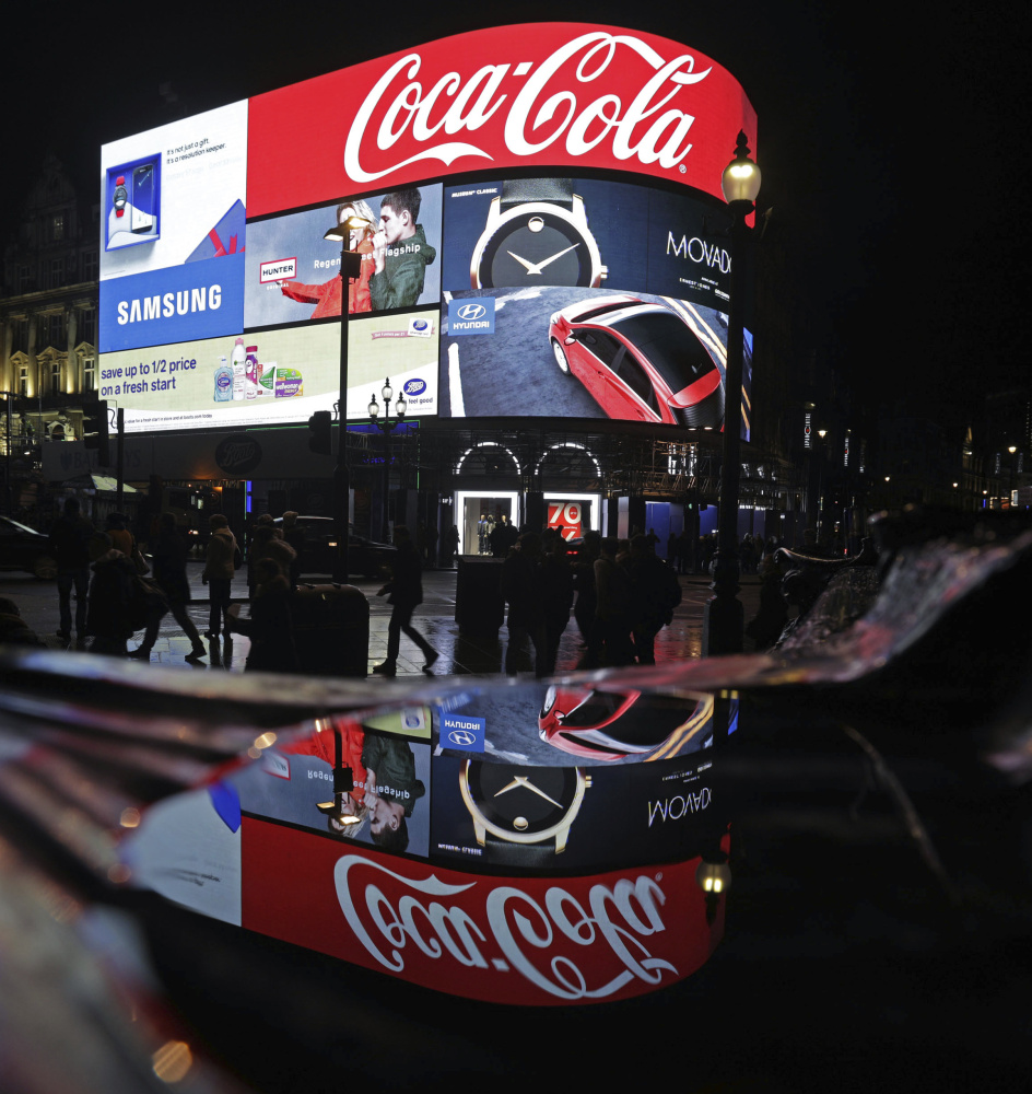 A general view of the advertising screens at Piccadilly Circus, central London, Sunday Jan. 15, 2017, before they were switched off in preparation for redevelopment. The iconic lights have gone out so that the electronic hoardings can be replaced with a state-of-the-art screen measuring 790 square metres which is expected to be unveiled in the autumn.  ()