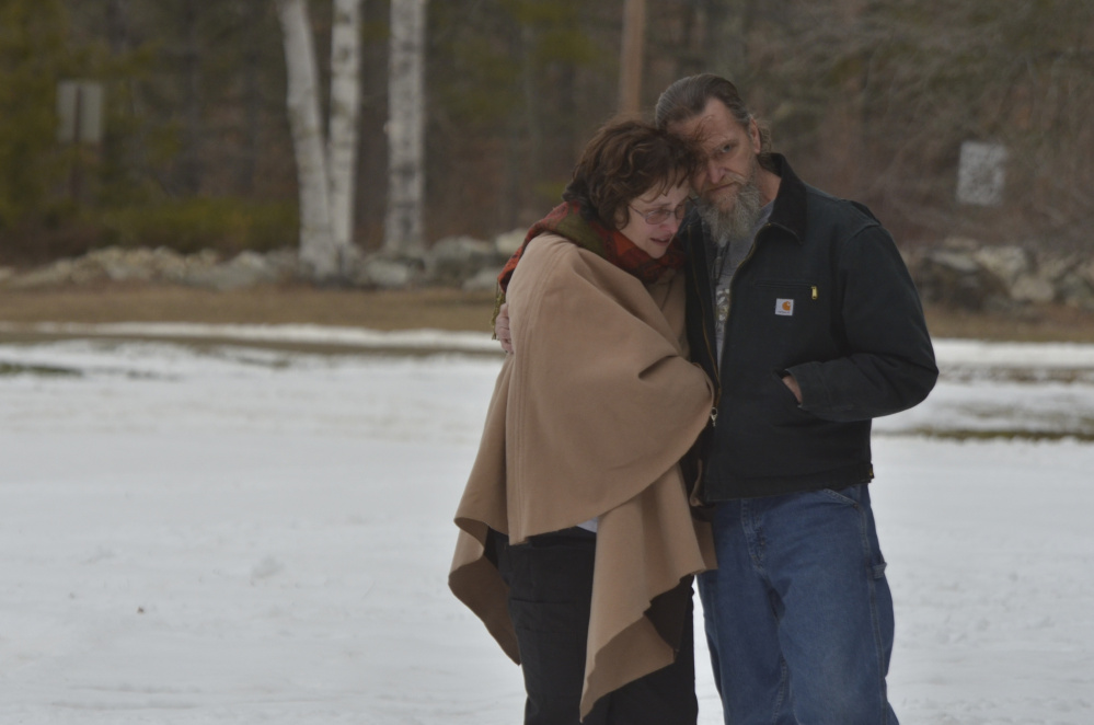 Kim Peabody, sister of Steven Rhodes, who died in a fire on Monday, is comforted by a friend at the fire scene on Cattle Pond Road in Washington. Peabody's nephew, Isaac Rhodes, also died in the fire.