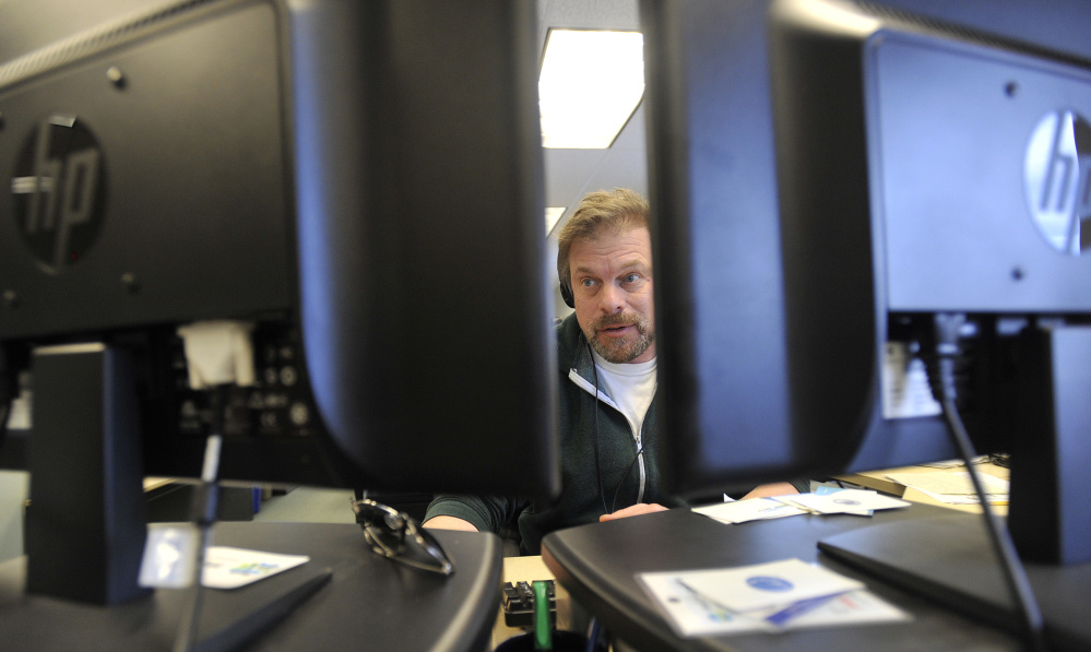 Reporter Fred Bever works in the newsroom at Maine Public Radio on Friday.