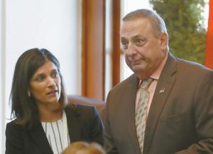 MAINE REPUBLICAN GOV. PAUL LEPAGE, right, and House Speaker Sara Gideon, D-Freeport, attend the Electoral College vote at the State House in Augusta in this December 2016 file photo.
