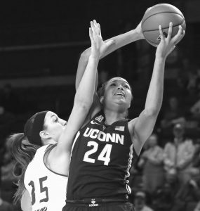 UCONN'S Napheesa Collier (24) shoots next to Tulsa forward Liesl Spoerl (35) during the first quarter of an NCAA college basketball game in Tulsa, Okla., on Tuesday.