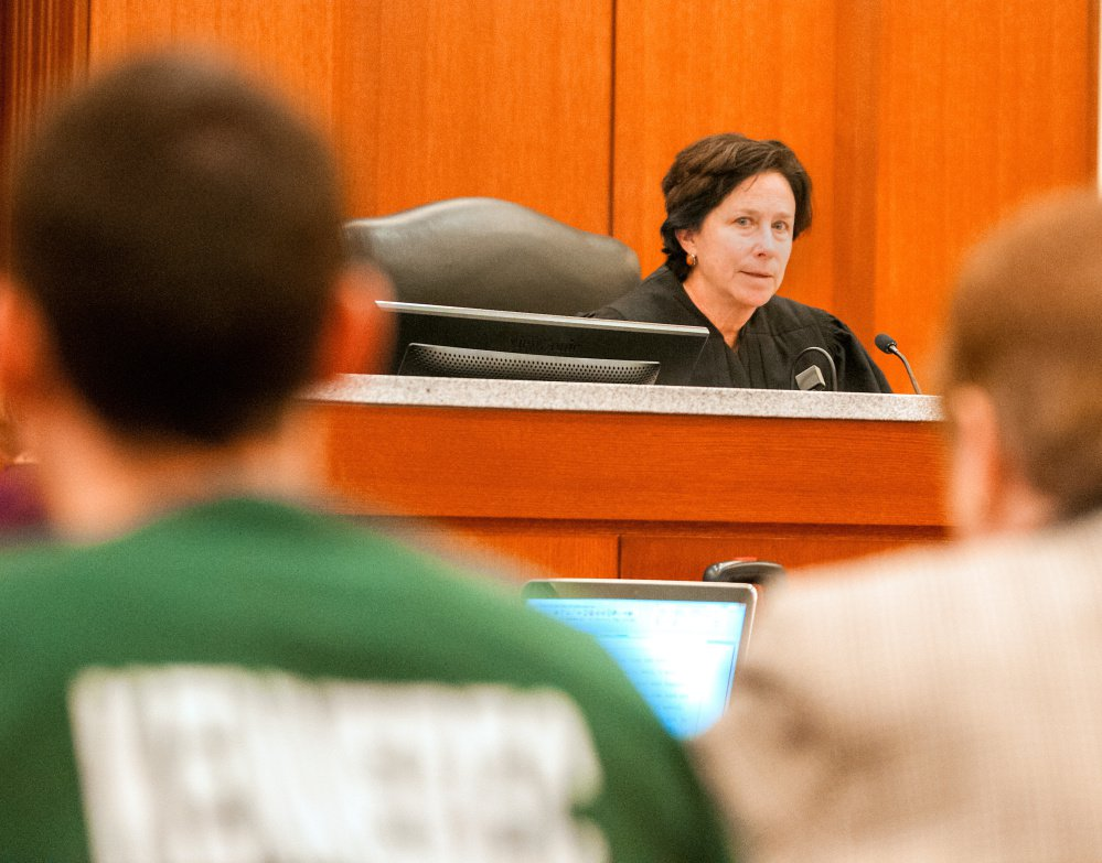 Mark D. Halle, left, and his attorney, Pamela Ames, right, listen as Justice Michaela Murphy, center, speaks during a hearing Thursday at the Capital Judicial Center in Augusta, where Halle withdrew his previous guilty pleas because he disagreed with the length of the sentence the judge said she would impose.