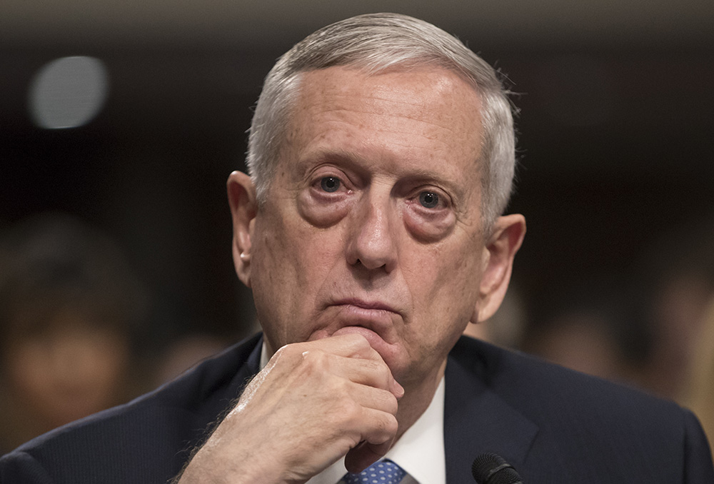 Defense Secretary-designate James Mattis listens to questions from Sen. Kirsten Gillibrand, D-N.Y., about his views on women and gays serving in the military, during his confirmation hearing before the Senate Armed Services Committee Thursday.