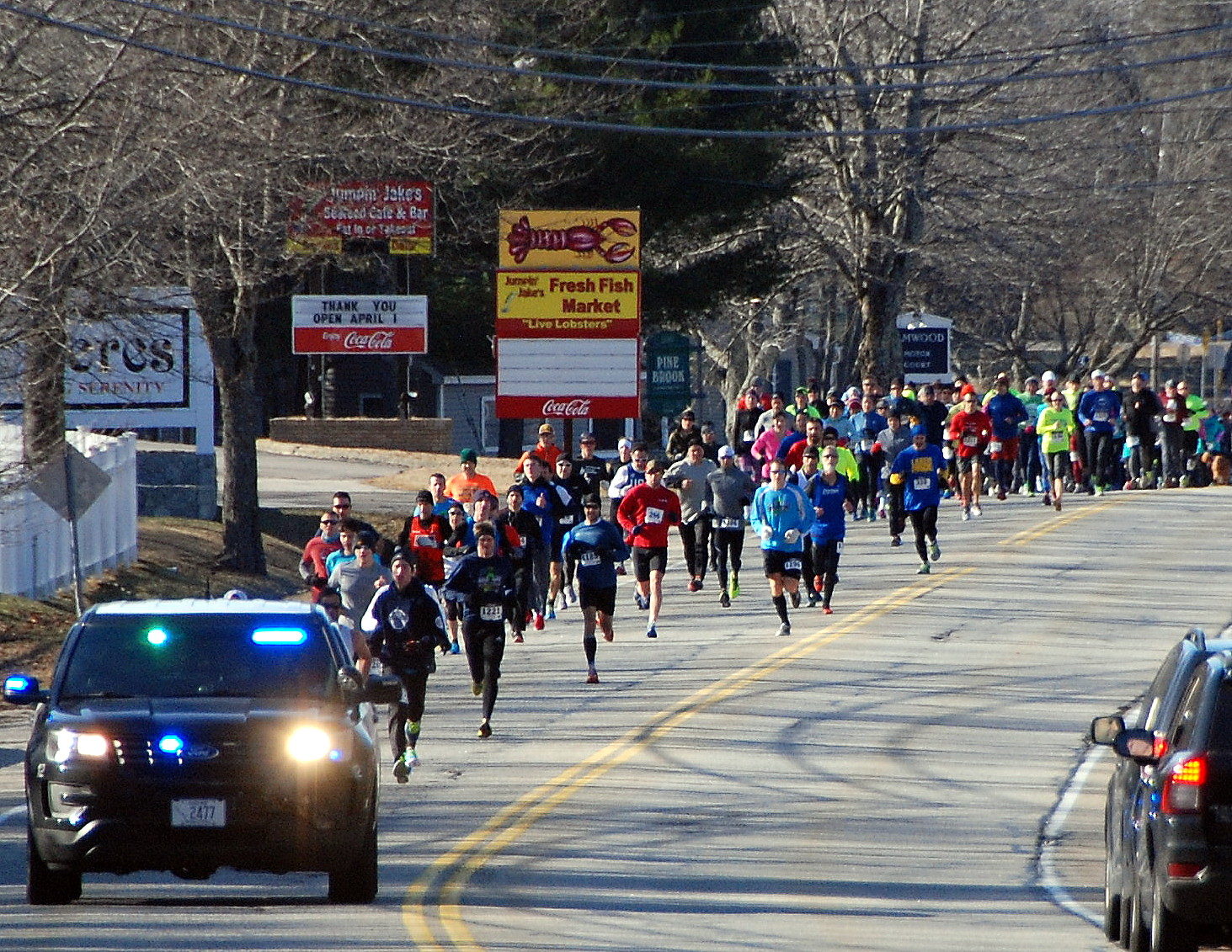 SUBMITTED PHOTO/Courtesy of Gary CurtisRunners race down Saco Avenue in Old Orchard Beach on Sunday morning during Jimmy the Greek's Frozen 4-Miler. The race raised money for camp scholarships through the Old Orchard Beach Recreation Department.