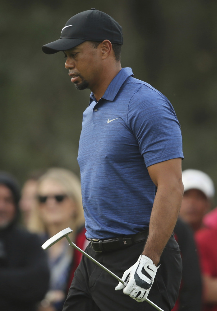 golf roundup  woods withdraws with back spasms