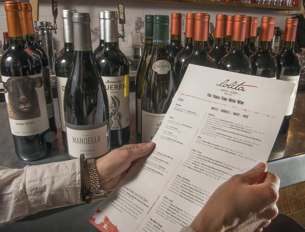 Stella Hernandez, co-owner of Lolita restaurant in Portland, with Lolita's wine list, which she wrote herself.