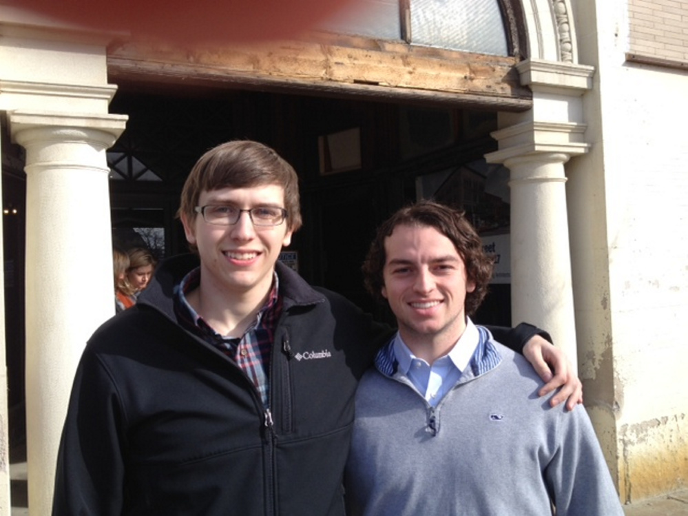 Colby sophomores Austin Nantkes, 19, of Lincoln, left, and Rob Durst, 21, of Dublin, California, stand outside the former Hains building Tuesday in downtown Waterville after attending the announcement of the new Alfond Leaders program.