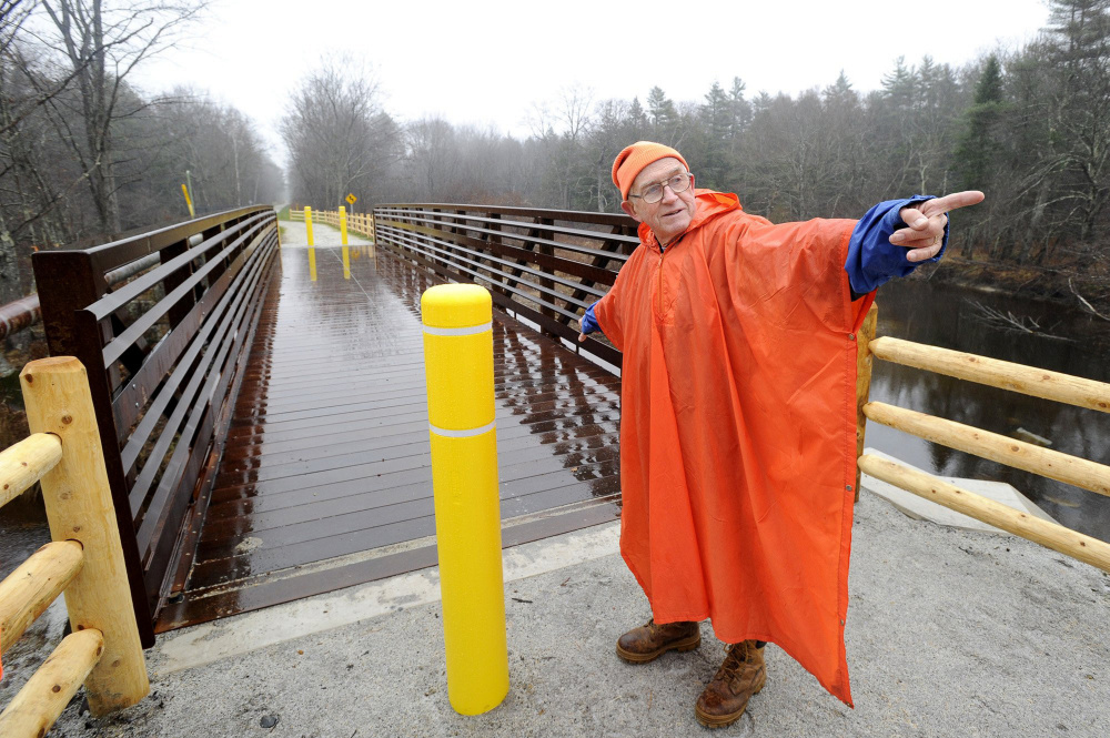 John Andrews points toward Kennebunk as he shows off a new section of the Eastern Trail in Arundel in November of 2010.