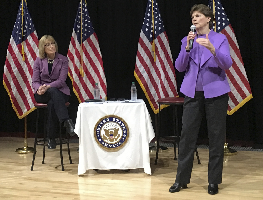 Democrat U.S. Sen. Maggie Hassan, left, listens as Sen. Jeanne Shaheen speaks to constituents during a town hall meeting Friday in Concord, N.H. Shaheen and Hassan took questions and talked about their efforts to fight against the policies President Trump.