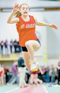 WYLEY FITZPATRICK of Mt. Ararat goes airborne in the girls long jump in Gorham on Monday.