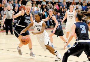 BOWDOIN COLLEGE GUARD Taylor Choate (4) drives past Connecticut College's Julia Wanfried during a NESCAC women's basketball quarterfinal at Brunswick on Saturday. Choate had 10 points as the Polar Bears captured a 72-47 win.
