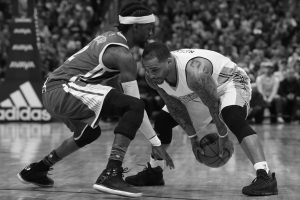 GOLDEN STATE WARRIORS guard Briante Weber, left, defends as Denver Nuggets guard Jameer Nelson picks up a loose ball in the second half of an NBA basketball game on Monday in Denver. The Nuggets won, 132-110.
