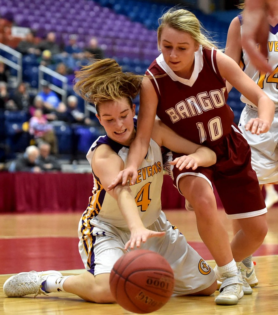 Cheverus' Kaylin Malmquist, 4, battles for the loose ball with Bangor's Lauren Young in the Class AA North quarterfinals at the Augusta Civic Center on Thursday.