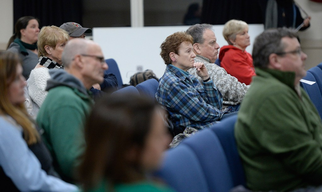 Residents at Tuesday night's meeting listen as the Ogunquit Select Board accepts Town Manager Thomas Fortier's letter of resignation. Some said the board should have fired Fortier.