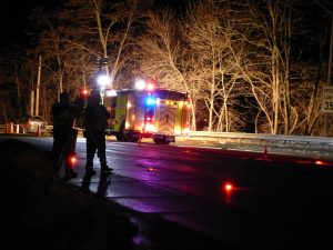 Mill Street was reduced to one lane Sunday night while Brunswick police reconstructed a crash that badly injured a 20-year-old Warren man. DARCIE MOORE/THE TIMES RECORD