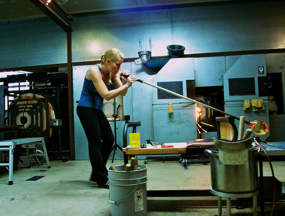 April Wagner works with a blow torch and hot glass in her Detroit, Mich., studio. The studio glass movement, which required a much smaller furnace to melt the glass, has made glass blowing more accessible and much more popular.