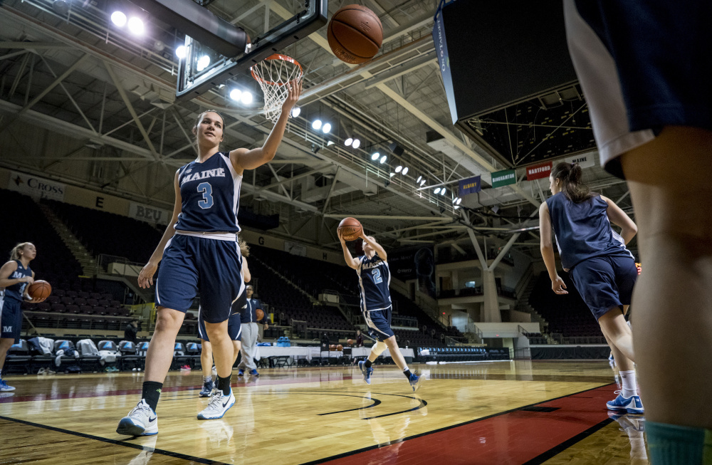 UMaine players warm up before a game in the America East Women's Basketball Tournament in Portland in March. The Cross Insurance Arena will host tournament games again in 2018, and conference officials said Monday that they would consider bringing the tournament back to Portland in later years.