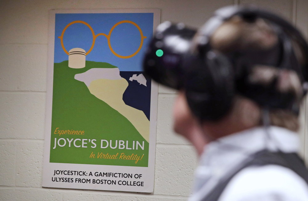 "Joseph Nugent, a professor of English at Boston College, wears virtual reality goggles at the school's virtual reality lab in Boston. College students in Boston are developing a virtual reality game based on James Joyce's ponderous tome ""Ulysses."" Nugent says the goal of ""Joycestick"" is to expose new audiences to the works of one of Ireland's most celebrated authors and to give a glimpse of how virtual reality can be used to enhance literature."