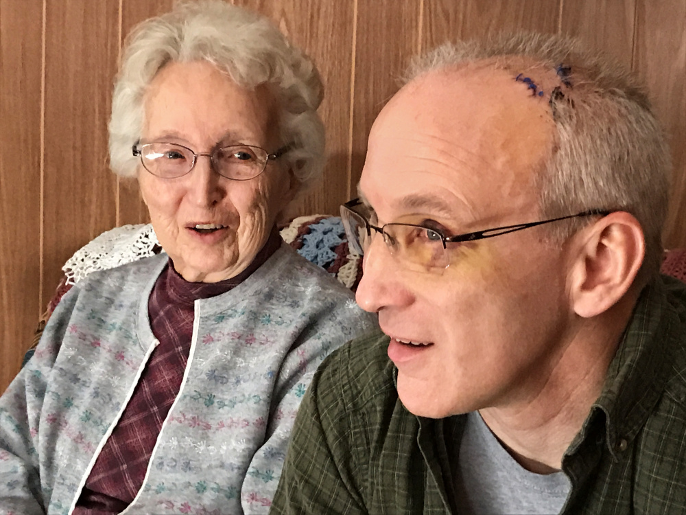 """Audrey Hewitt and her son Eric Hewitt talk about last week's home invasion. """"I could hear him out there wrestling, and I thought, 'Oh God, don't hurt Eric,' """" said Audrey."""