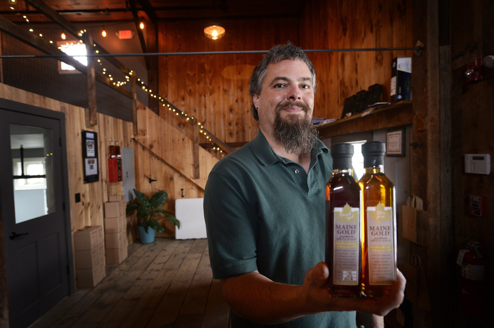 Scott Arndt of Maine Gold, pictured above, and David Woods, owner of Wiggly Bridge Distillery, are believed to be the first Mainers to jump on a trend that is spreading throughout the rest of New England: producing barrel-aged maple syrups.