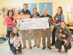 """SUBARU OF NEW ENGLAND presents Coastal Humane Society with a donation of $10,000 on Tuesday. As part of the Subaru Love Promise, Subaru of New England launched its second annual #SNELovesPets fundraising campaign during the month of October 2016 as a way to raise awareness of animal health, safety, and happiness. Subaru of New England vowed to donate $5 for every pet picture uploaded and tagged with #SNELovesPets on Instagram, Twitter, and Facebook by pet owners and advocates. """"Subaru of New England's commitment to supporting shelter pets is inspiring and their generosity will help us care for the 3,300 dogs, cats and critters that come through our doors every year at our two facilities. Their donation will help us care for these animals; providing them with food, medical care and comfort. More importantly, it will help us continue to get 98% of these animals out of our shelters and home to stay,"""" said Joe Montisano, Executive Director for Coastal Humane Society and Lincoln Country Animal Shelter. Standing, left to right: Jane Siviski (Marketing Manager), Patrick Winther (SNE), Brittney Kunst (Animal Care Technician), Joe Montisano (exeuctive director, CHS and LCAS), Abby Malone (Foster Coordinator and Animal Care Technician). Kneeling, left to right: Olivia Bresnahan (Animal Care Technician), Kelsey Michaud (Animal Care Technician)."""