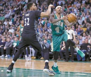 BOSTON CELTICS GUARD Isaiah Thomas (4) drives to the basket against Minnesota Timberwolves center Karl-Anthony Towns (32) during the second quarter of an NBA basketball game in Boston on Wednesday.