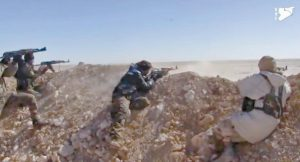 THIS FRAME GRAB from a video provided by the Syria Democratic Forces, shows fighters from the SDF opening fire on an Islamic State group's position, in Raqqa's eastern countryside, Syria, Monday. The main U.S.-backed force fighting the Islamic State group in Syria has enough fighters to capture the extremists' de facto capital of Raqqa north of the country at a time when U.S. troops are playing a bigger role on the ground in the battle to conquer the city, a spokeswoman for the force said Friday.