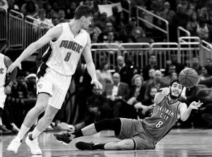 OKLAHOMA CITY'S Alex Abrines, right, passes around Orlando's Mario Hezonja, left, after scooping up a loose ball during the first half of an NBA basketball game on Wednesday.