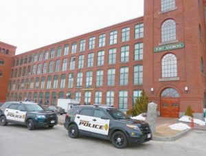 CRUISERS SIT in front of the entrance to the Fort Andross Mill complex on Maine Street in Brunswick as police investigate a shooting that took place in the building Tuesday.
