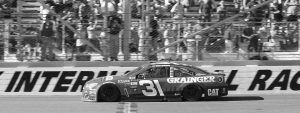 RYAN NEWMAN takes the checkered flag to win the NASCAR Cup Series auto race at Phoenix International Raceway on Sunday in Avondale, Ariz.