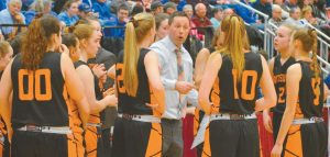 BRUNSWICK HIGH SCHOOL girls basketball coach Sam Farrell talks to his team during a second-half timeout in Saturday's Class A State Championship game at the Augusta Civic Center. The Dragons fell to Messalonskee, 58-33.