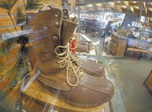 A EARLY VERSION of the Maine Hunting Shoe is displayed at the L.L. Bean flagship store in Freeport, Maine, Friday. The company reported a slight increase in sales for 2016 and said Friday that employees will be given a 3 percent annual bonus. The family-owned company said annual net sales last year were $1.6 billion.