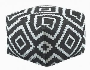 THIS PHOTO shows the Hailey pouf which is covered in a bold geometric kilim material.